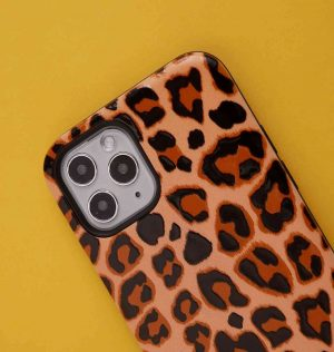 Phone case with brown leopard print design set against a yellow background