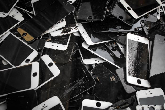 Pile of phones with cracked screens