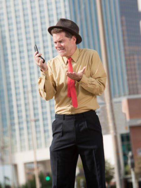 Businessman frustrated due to lack of signal